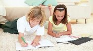 Siblings drawing together Stock Footage