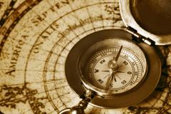 Stock Photo of old compass on vintage map