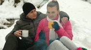 Stock Video Footage of Couple Basking By The Fire In Winter Forest