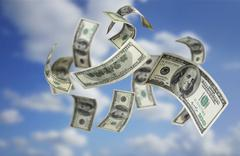Falling money $100 bills Stock Photos