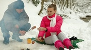 Young Couple On Picnic In Winter Forest Stock Footage