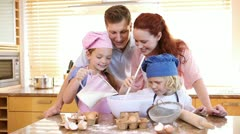 Family making a cake Stock Footage