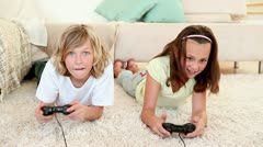 Brother and sister playing video games Stock Footage
