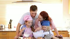 Family standing while cooking together Stock Footage