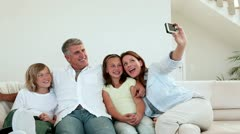 Family posing for a photo Stock Footage