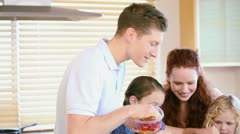 Family standing while preparing a meal Stock Footage