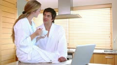 Couple in bathrobes on a video chat Stock Footage