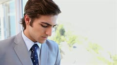 A businessman next to a window Stock Footage