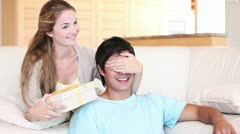 Woman giving a gift to her husband Stock Footage
