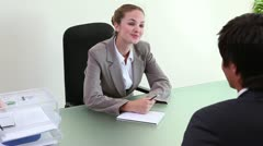 Businesswoman interviewing an applicant Stock Footage