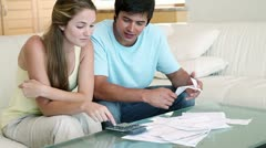 Stock Video Footage of Young couple doing their accounts