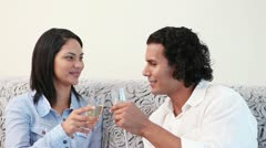Couple clinking glasses of sparkling wine Stock Footage