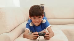Boy loses at his video game Stock Footage
