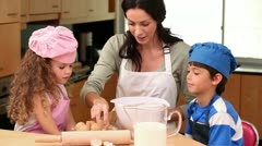 Mother cooking with her children - stock footage