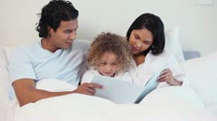 Family looking a child book Stock Footage