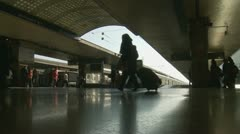 Silhouette passengers at a train station Stock Footage