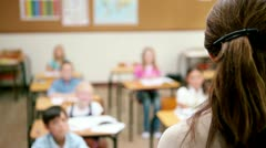 Teacher speaking to her pupils Stock Footage