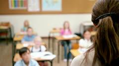 Teacher speaking to her pupils - stock footage