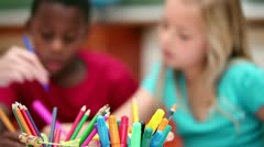 Stock Video Footage of Pupils sitting behind coloring pens