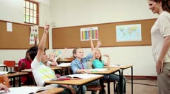 Cheerful pupils raising their fingers Stock Footage