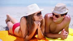 Couple lying on towels Stock Footage