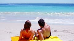 Couple looking at the ocean Stock Footage