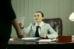 Boss giving reprimand to female worker, steadicam shot - stock footage