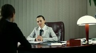 Boss communicate bad news to female worker, steadicam shot Stock Footage