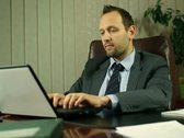 Stock Video Footage of Businessman with laptop in office, steadicam shot