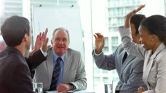 Colleagues giving high-five in slow motion Stock Footage