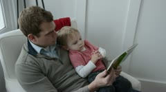 Toddler boy and dad reading a book 8979 Stock Footage