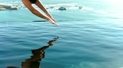 Woman diving into the water in slow motion Stock Footage