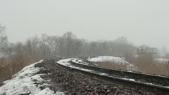 Passenger train on the railway in the winter woods. - stock footage