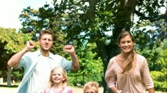 Family jumping together in slow motion Stock Footage