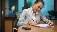 Boss signing documents in her office, steadicam shot Stock Footage