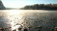 Mist above the snowy river in winter morning. Stock Footage