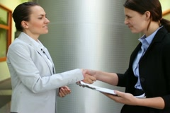Business partners handshake after signing new contract, steadicam shot - stock footage
