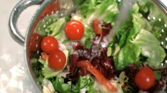 Salad being washed in super slow motion Stock Footage