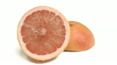 Water sprayed on grapefruit in super slow motion Stock Footage