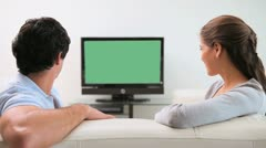 Couple looking at the television screen - stock footage