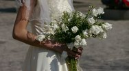 Bride carrying a bouquet of flowers. Stock Footage