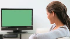 Brunette woman watching the television Stock Footage