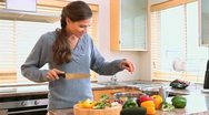Brunette woman cooking Stock Footage