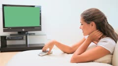 Woman smiling while watching the television Stock Footage