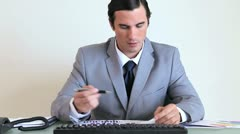 Serious businessman working on charts Stock Footage