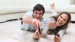 Happy couple playing video games Stock Footage