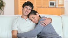 Couple sitting together on a couch Stock Footage