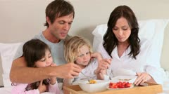 Smiling family eating their breakfast Stock Footage