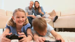 Siblings playing games with controllers Stock Footage