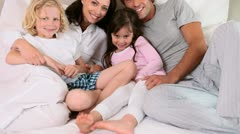 Smiling family lying in a bed Stock Footage